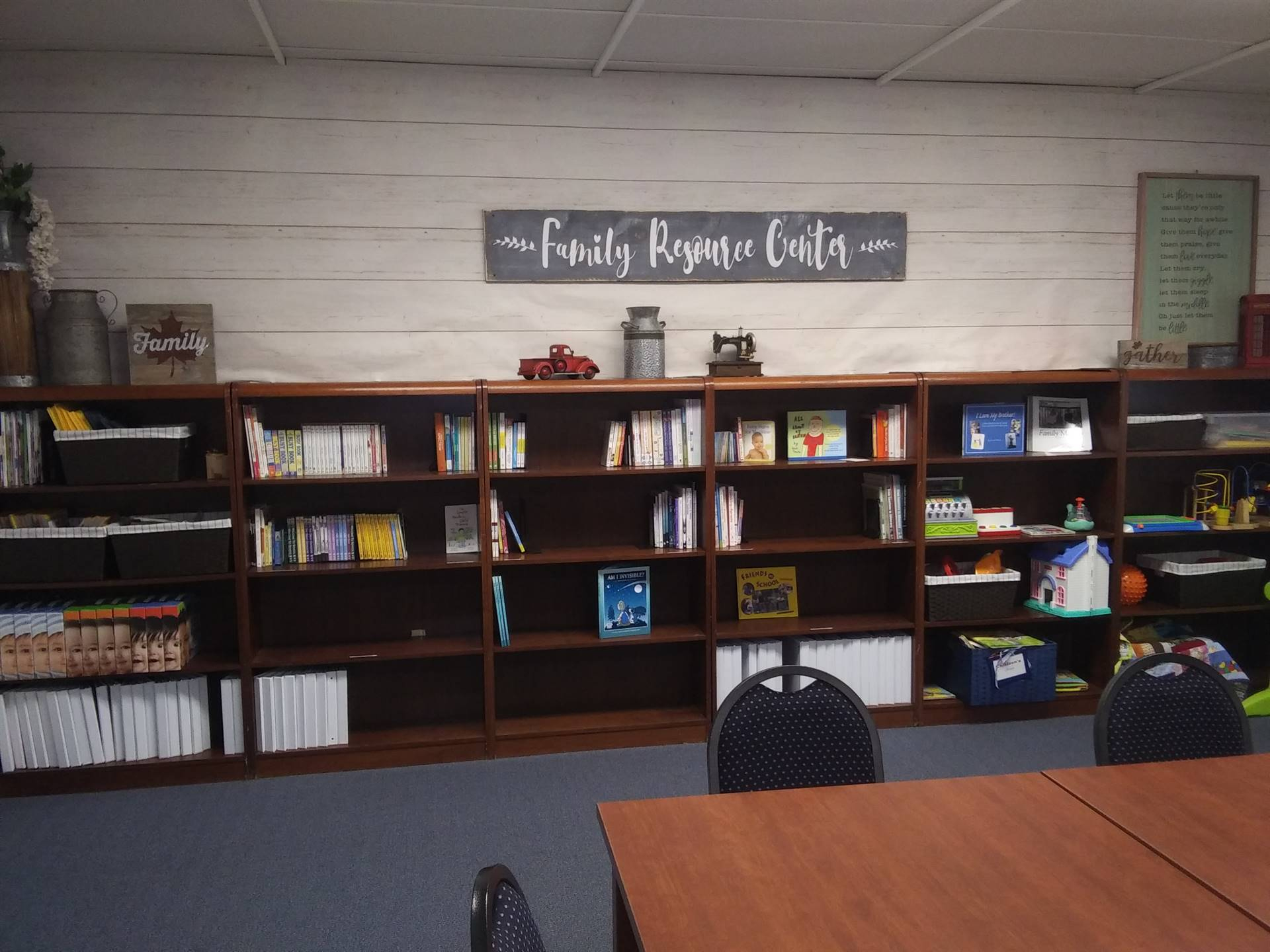 FRC Library brown bookcase with books and toys