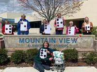 Braille Team Encouraging Photo