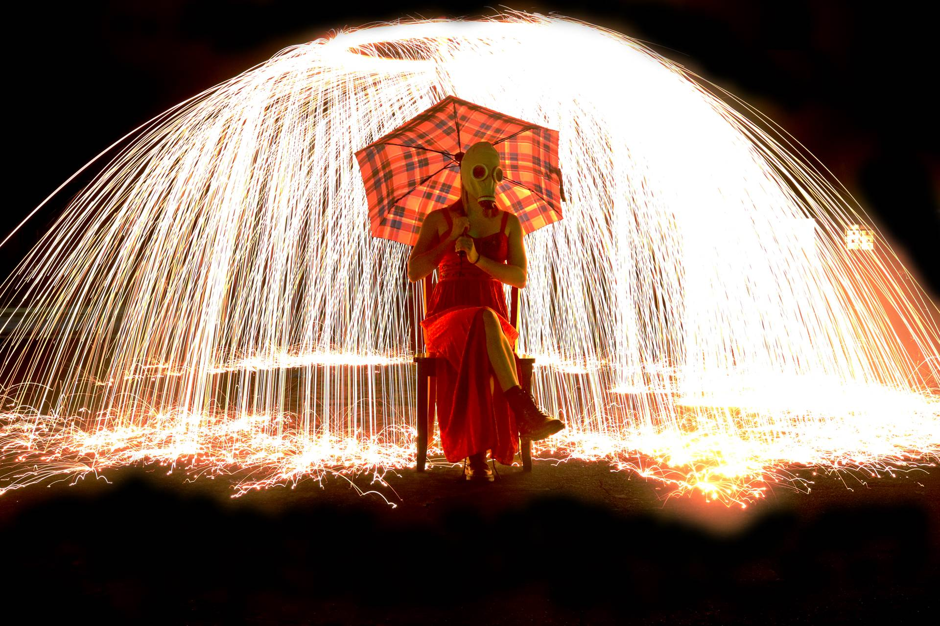 Girl with umbrella and sparklers raining near her