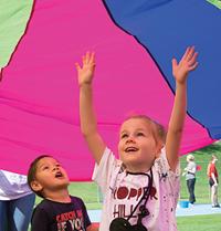 kids under parachutes