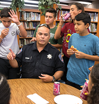 Officer with students
