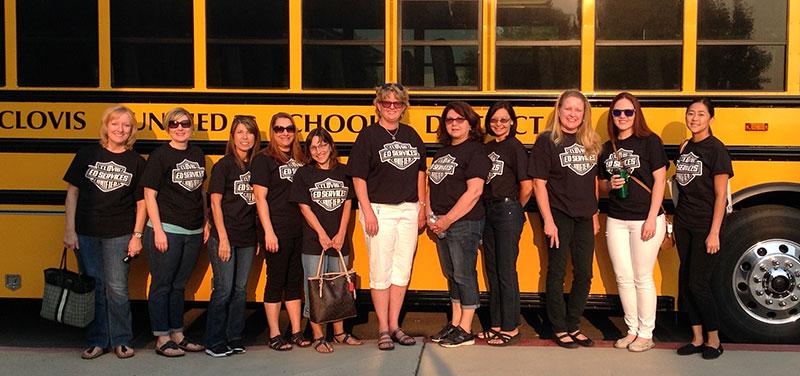 Nurses in front of a school bus